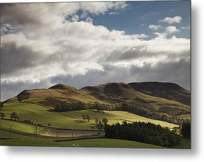 A Landscape With Rolling Hills And Metal Print by John Short