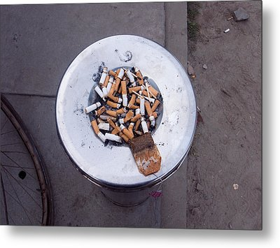 A Lot Of Cigarettes Stubbed Out At A Garbage Bin Metal Print by Ashish Agarwal