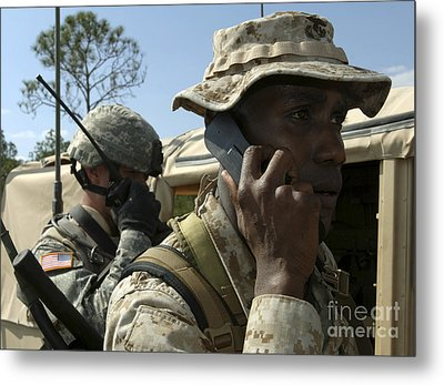 A Marine Communicates With Aircraft Metal Print by Stocktrek Images