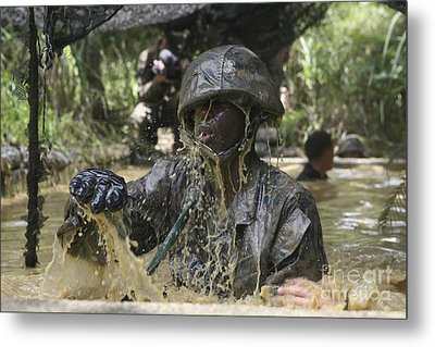 A Marine Splashes As He Makes His Way Metal Print by Stocktrek Images
