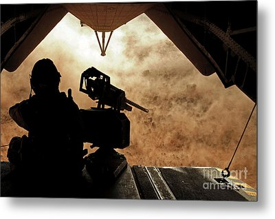 A Marine Waits For Dust To Clear While Metal Print by Stocktrek Images
