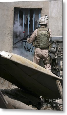A Military Policeman Uses A Breaching Metal Print by Stocktrek Images