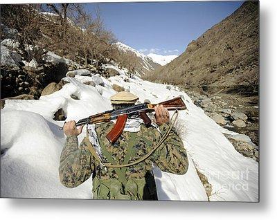 A Mujahadeen Guard Walks With U.s Metal Print