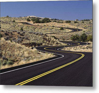 A Newly Paved Winding Road Up A Slight Metal Print by Greg Probst