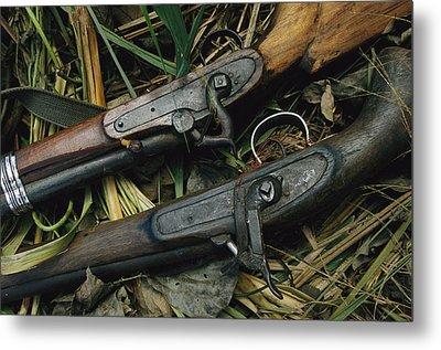 A Pair Of Old Flint-type Rifles Lying Metal Print by Steve Winter
