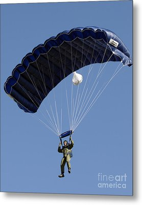 A Paratrooper Descends Through The Sky Metal Print by Stocktrek Images
