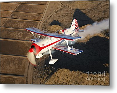 A Pitts Model 12 Aircraft In Flight Metal Print by Scott Germain