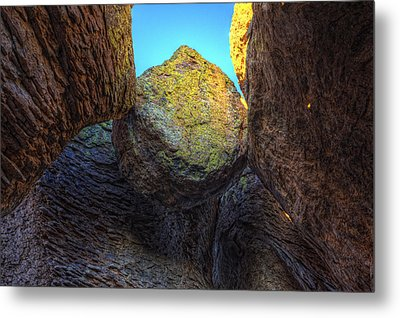 A Rock Balanced Precariously Metal Print by Robert Postma