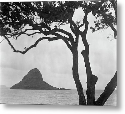 A Rock Formation In The Pacific Ocean, Oahu, Hawaii Metal Print by Brian Caissie