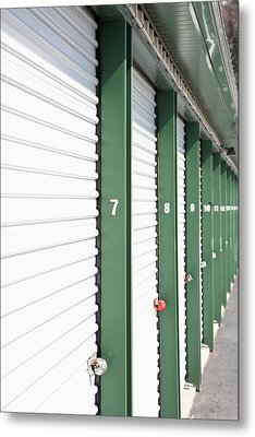 A Row Of Locked Storage Units At A Self Storage Facility Metal Print by Frederick Bass