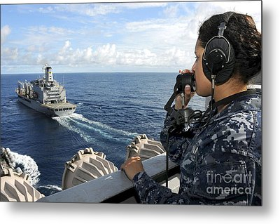 A Sailor Stands Forward Lookout Watch Metal Print by Stocktrek Images