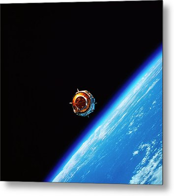 A Satellite In Orbit Above Earth Metal Print by Stockbyte