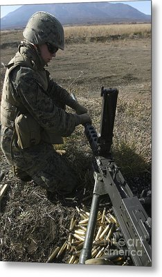 A Soldier Changes The Barrel Of An M2 Metal Print by Stocktrek Images