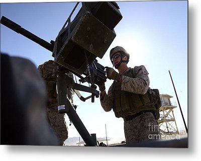 A Soldier Fires 40mm Rounds Metal Print by Stocktrek Images