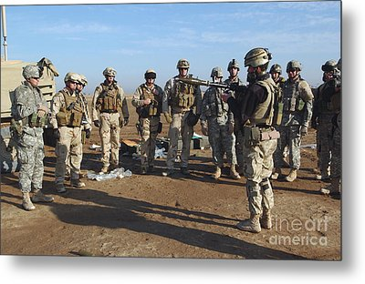 A Soldier Teaches How To Properly Metal Print by Stocktrek Images