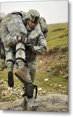 A Soldier Transports A Fellow Wounded Metal Print by Stocktrek Images