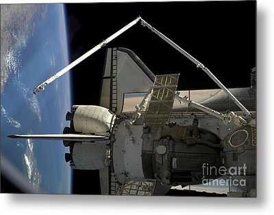 A Soyuz Vehicle And The Space Shuttle Metal Print by Stocktrek Images
