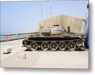 A T-55 Tank On The Seafront Metal Print by Andrew Chittock