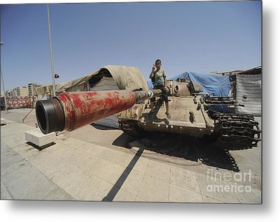 A T-55 Tank With Two Children Playing Metal Print by Andrew Chittock