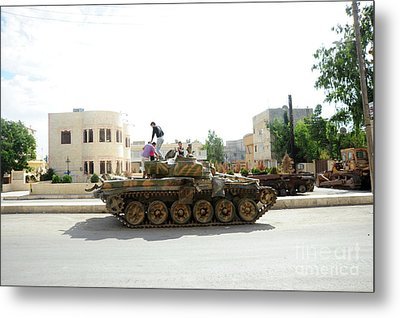 A T-72 Main Battle Tank On The Streets Metal Print by Andrew Chittock