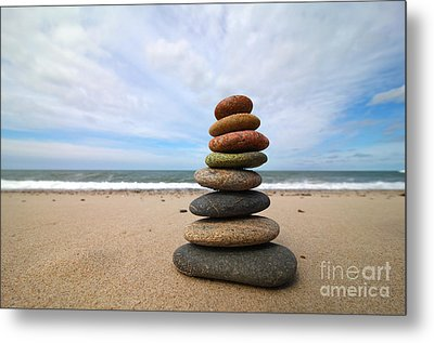A Tower Of Stones On The Beach Metal Print by Holger Ostwald