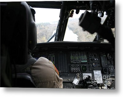 A Uh-60 Blackhawk Flies The River To An Metal Print by Terry Moore