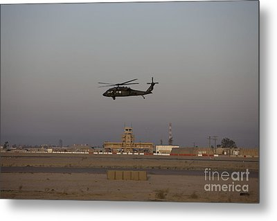 A Uh-60 Blackhawk Helicopter Flies Metal Print by Terry Moore