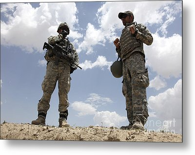A U.s. Army Soldier Communicates Metal Print by Stocktrek Images