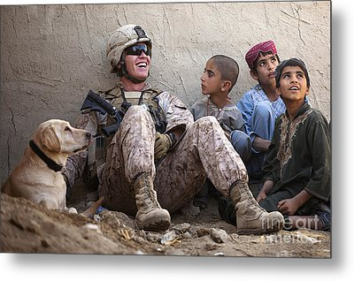A U.s. Marine Jokes With Afghan Metal Print by Stocktrek Images