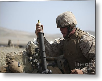 A U.s. Marine Loads A Mortar Metal Print by Stocktrek Images