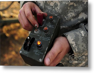 A U.s. Soldier Hits The Button Metal Print by Stocktrek Images
