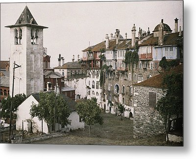 A White Bell Tower Stands Bright Metal Print by Maynard Owen Williams