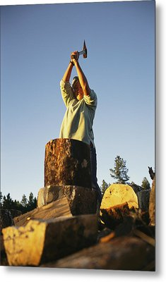 A Woman Chops Wood With Metal Print by Bobby Model