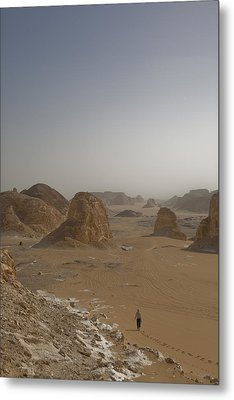 A Woman Walks Down A Sand Dune Metal Print by Taylor S. Kennedy