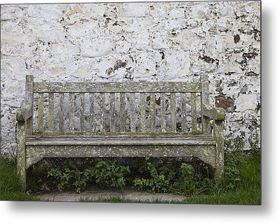A Wooden Bench With Peeling Paint Metal Print by John Short