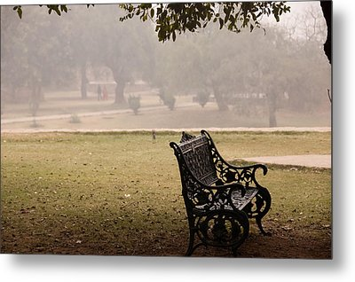 A Wrought Iron Black Metal Bench Under A Tree In The Qutub Minar Compound Metal Print by Ashish Agarwal