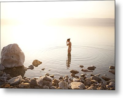 A Young Woman Wades Into The Dead Sea Metal Print by Taylor S. Kennedy