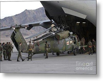 Airmen Load An Hh-60 Pave Hawk Metal Print by Stocktrek Images