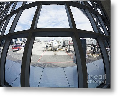 Airplane Parked At Gate Metal Print by Don Mason