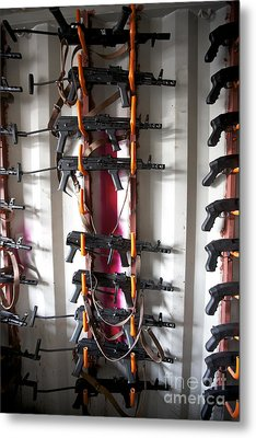 Akm Assault Rifles Lined Up On The Wall Metal Print by Terry Moore