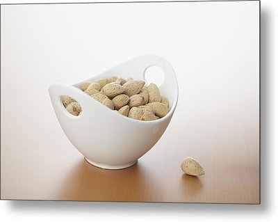 Almonds In Bowl Metal Print by Bruce Law