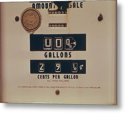 An Abandoned Gasoline Pump With A Price Metal Print by Everett