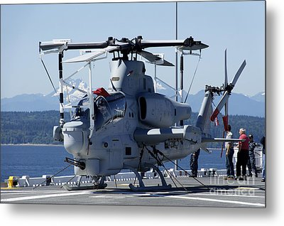 An Ah-1w Cobra Is Chained To The Flight Metal Print by Stocktrek Images