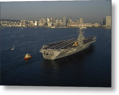 An Aircraft Carrier With The Skyline Metal Print by Phil Schermeister