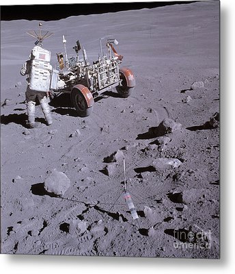 An Astronaut And A Lunar Roving Vehicle Metal Print by Stocktrek Images