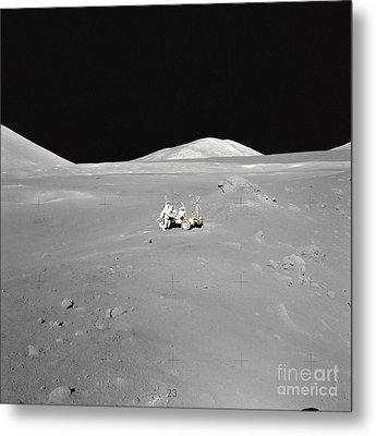 An Astronaut Working At The Lunar Metal Print by Stocktrek Images