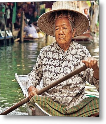 An Elderly Lady Rowing Along The Metal Print