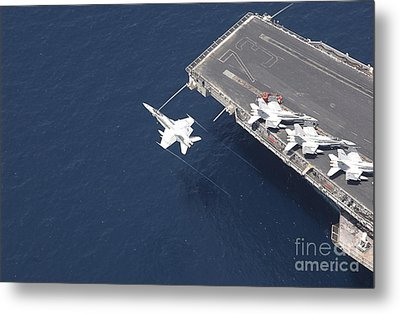 An Fa-18 Hornet Flys Over Aircraft Metal Print by Stocktrek Images