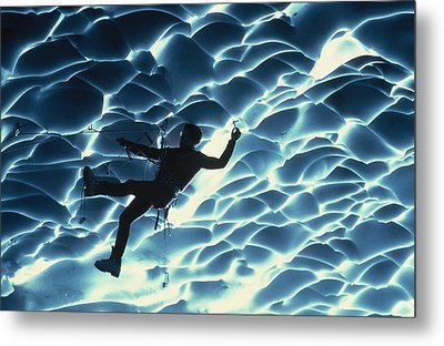 An Ice Climber Crosses The Ceiling Metal Print by Carsten Peter