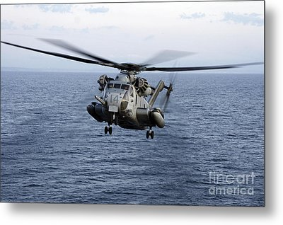 An Mh-53e Sea Dragon In Flight Metal Print by Stocktrek Images